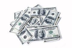 Доллары изолированные на белизне Стоковая Фотография