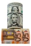Доллары и евро валюты свернули на белой предпосылке Стоковое фото RF