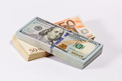 Доллары и евро Стоковые Фото
