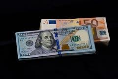 Доллары и евро Стоковая Фотография RF