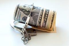 Доллары и наручники Стоковая Фотография