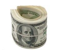 Доллары крена изолированного на белизне Стоковые Изображения