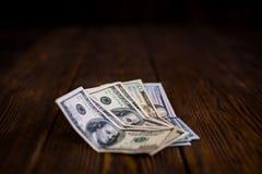 Доллары на деревянном поле Стоковые Фото