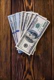 Доллары на деревянном поле Стоковые Фотографии RF
