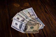 Доллары на деревянном поле Стоковое Изображение RF