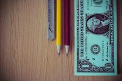 Доллары на деревянном столе Винтажные фильтры фото Стоковое фото RF