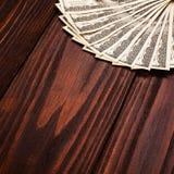 Доллары на деревянном столе Стоковая Фотография RF