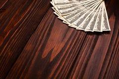Доллары на деревянном столе Стоковые Изображения