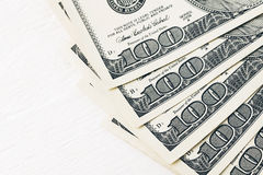 Доллары на деревянном столе Стоковые Фотографии RF