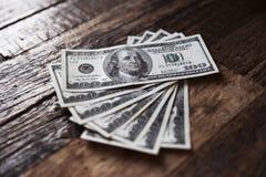 Доллары на деревянном столе Стоковые Изображения RF