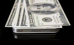 Доллары на телефоне Стоковые Изображения RF