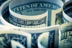 Доллары свернули крупный план Американские доллары денег наличных денег доллар 100 одно кредиток Стоковые Изображения