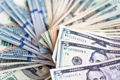 Доллары счетов на белой предпосылке Стоковые Фото