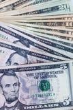 Доллары счетов на белой предпосылке Стоковая Фотография