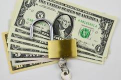 Доллары США с padlock Стоковая Фотография