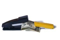 Доллары укуса сшивателей Стоковая Фотография