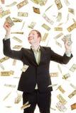 Доллары человека заразительные под дождем доллара Стоковые Фотографии RF