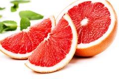 Дольки грейпфрута на белой предпосылке Стоковые Фотографии RF
