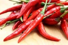 древесина красного цвета горячего перца chili предпосылки Стоковые Изображения