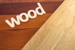 Древесина слова на деревянном настиле Стоковые Изображения RF