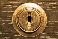 древесина keyhole крупного плана предпосылки золотистая Стоковые Фотографии RF