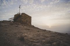 древняя крепость Masada на зоре Руины старой еврейской крепости в пустыне Осмотр достопримечательностей в Израиле archfiend стоковое фото rf