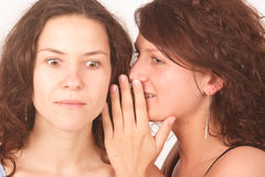 другой один секрет говоря к женщине Стоковое фото RF