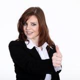 Дружелюбная бизнес-леди с thump вверх Стоковые Фото