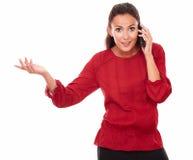 Дружелюбная молодая дама говоря на ее телефоне Стоковые Фото
