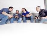 Друзья используя их мобильные телефоны Стоковая Фотография RF