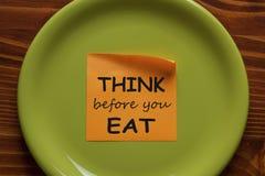 Думайте прежде чем вы едите стоковое изображение rf