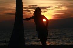 Думать на заходе солнца Стоковые Фотографии RF