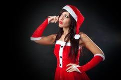 Думать одежд девушки Santa Claus Стоковые Изображения RF