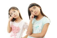 Думая азиатские девушки Стоковые Фото