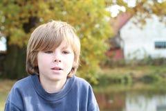 Думая унылый мальчик Стоковое Изображение RF