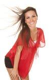 Дуновение волос красного верха женщины постное стоковое фото rf