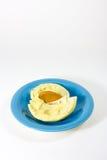 Дуриан на голубом блюде Стоковая Фотография