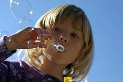 дуя девушка пузырей Стоковое фото RF