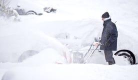 дуя снежок человека стоковые фото
