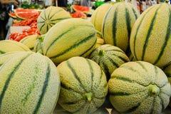 Дыни на рынке Стоковые Фото