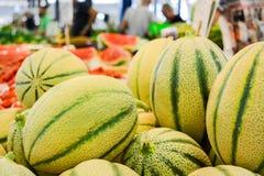 Дыни на рынке Стоковая Фотография RF
