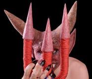 Дьявол смотрит от за трёхзубца Стоковая Фотография RF