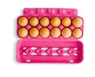 Дюжина яичек в розовой коробке Стоковые Фотографии RF