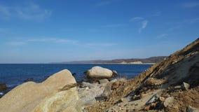 Дюны, утесы, океан и небо стоковая фотография