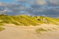Дюны Liepaja на облачном небе Стоковые Фото