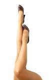 Длинные милые ноги женщины на белой предпосылке Стоковое фото RF