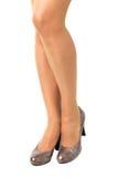Длинные милые ноги женщины на белой предпосылке Стоковое Изображение