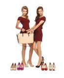 2 девочка-подростка в красных платьях с сумкой Стоковое фото RF