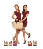 2 девочка-подростка в красных платьях с сумкой Стоковые Изображения RF