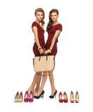 2 девочка-подростка в красных платьях с сумкой Стоковые Фото